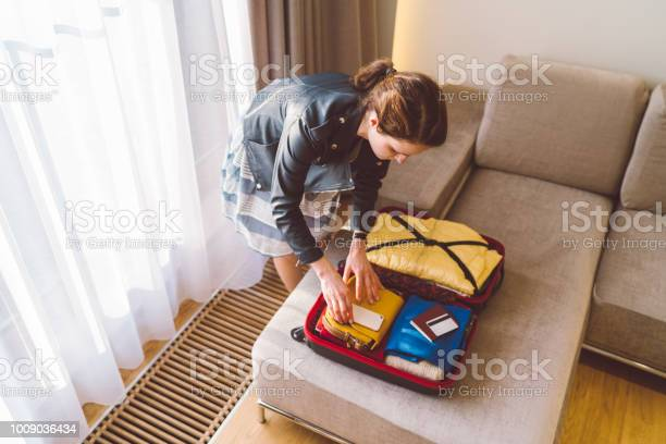 Tourist woman in hotel packing the suitcase before leaving picture id1009036434?b=1&k=6&m=1009036434&s=612x612&h=mkl2j4mxxkvnm8manip7suecxovwgho9w itdcthhoo=