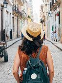 Tourist woman in La Havana city, Cuba. Rear view.