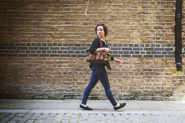 tourist woman in london - stalking stock photos and pictures