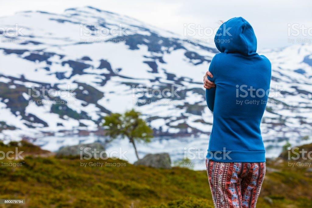 Tourist woman in mountains Norway stock photo