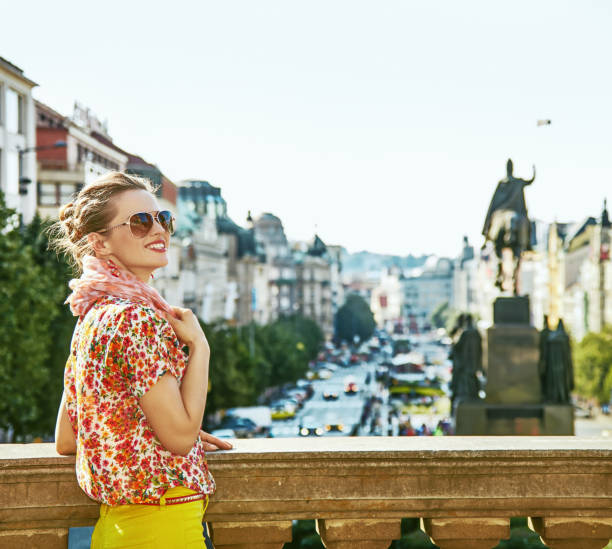 tourist woman on Vaclavske namesti in Prague having excursion The spirit of old Europe in Prague. happy modern tourist woman on Vaclavske namesti in Prague, Czech Republic having excursion wenceslas square stock pictures, royalty-free photos & images