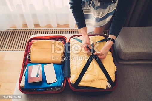 Close-up of woman preparing luggage