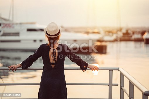 Rear view of tourist woman ready for boarding on passenger ship