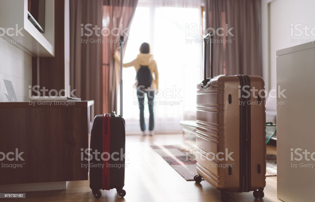 Tourist woman staying in luxury hotel stock photo
