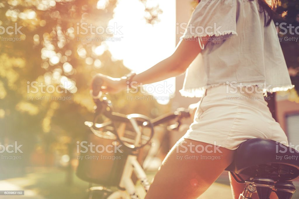Tourist woman using bicycle stock photo