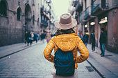Rear view of young woman enjoying Barcelona