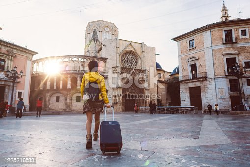 Woman with suitcase just arriving in Valencia