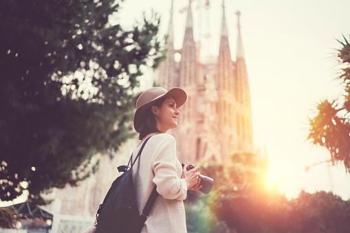 Tourist woman with camera exploring Bracelona