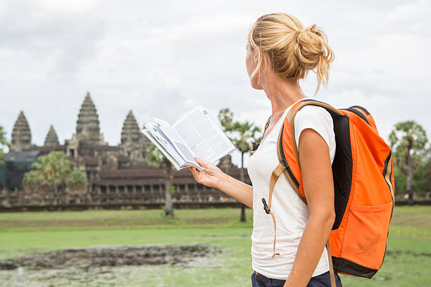 Tourist woman with travel guidebook in Cambodia stock photo