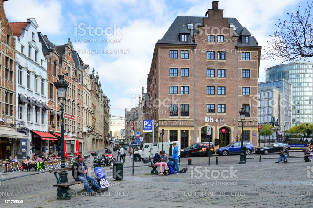 Touristic area of Grass Market (Grasmarkt) at Agora Square surrounded by preserved historic buildings from the 17th-18th century, near the famous Grand Place in city center of Brussels, Belgium stock photo