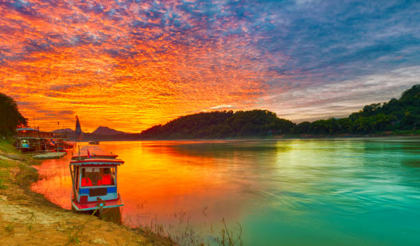 touristic boat at sunset. beautiful landscape. luang prabang. laos. - mekong river stock pictures, royalty-free photos & images