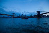 New York, NY, United States - November 12th, 2012: East River on a touristic boat and bridges.