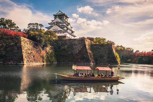 Touristic boats with tourists along the moat of Osaka Castle, Osaka, Japan