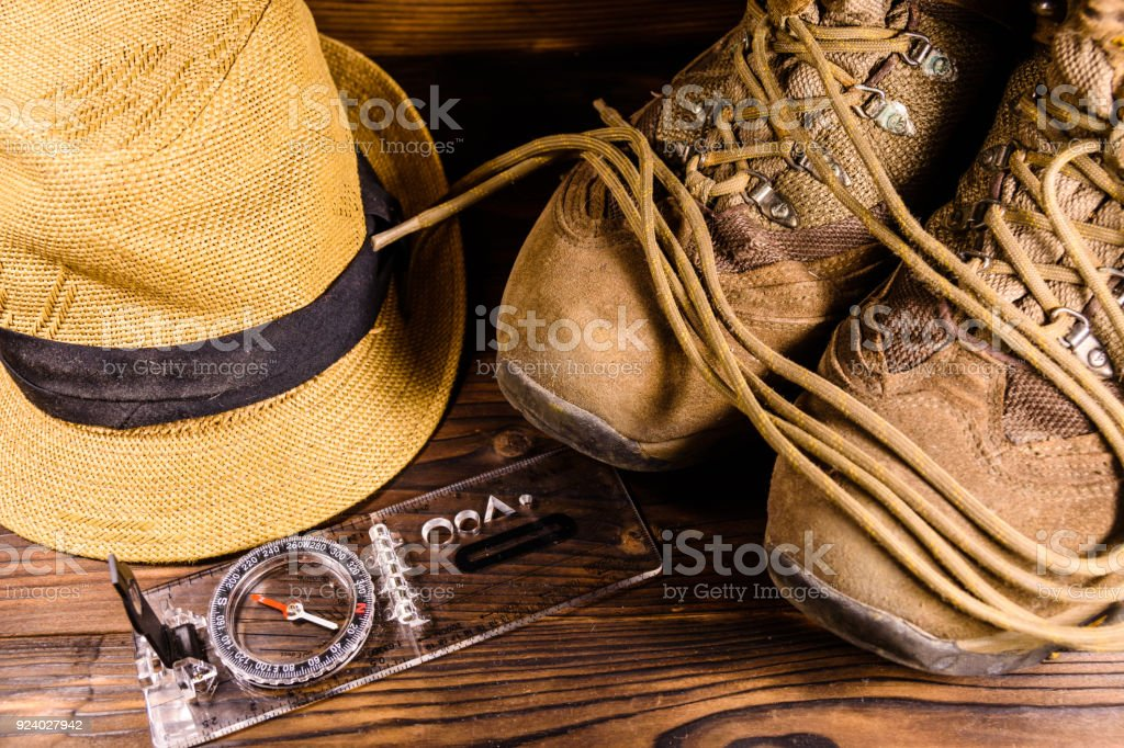 9ce69f32699 Touristic Magnetic Compass Boots And Hat On Wooden Table Stock Photo ...