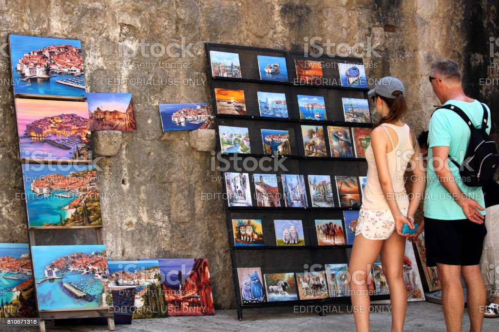 Touristic paintings sold as souvenirs in Dubrovnik stock photo