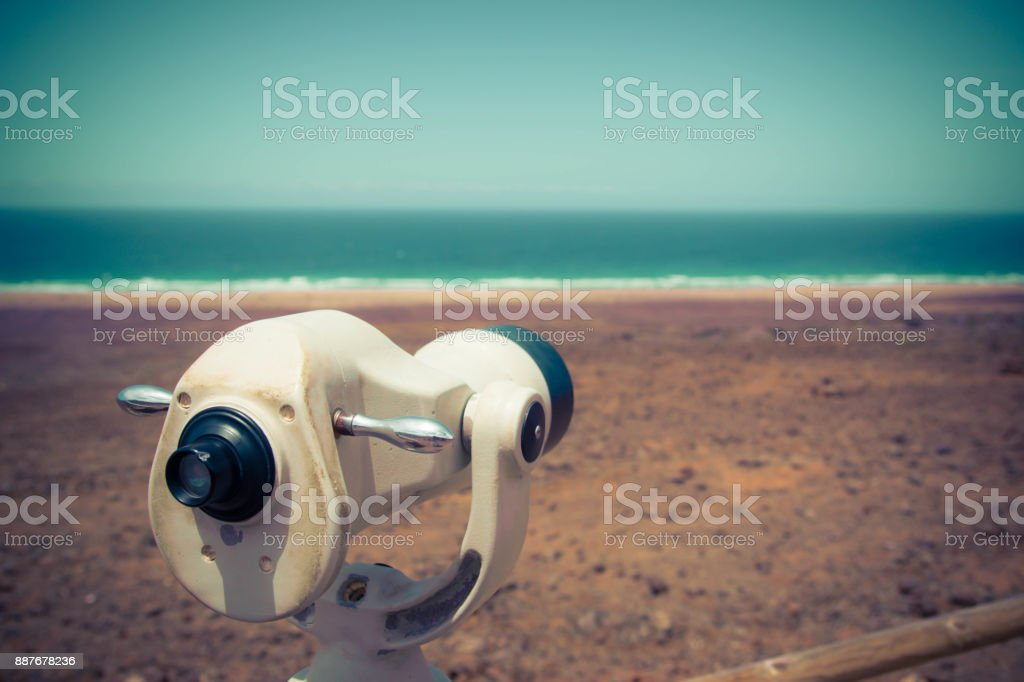 Touristic telescope looking at the sea. stock photo