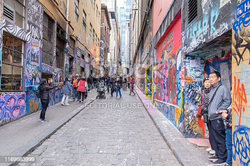 488380038 istock photo Tourists admiring one of the famous graffiti alleys in Melbourne CBD 1169663999