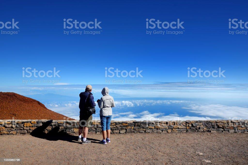 Tourists admiring stunning landscape view of Haleakala volcano area from the summit. Maui, Hawaii, stock photo