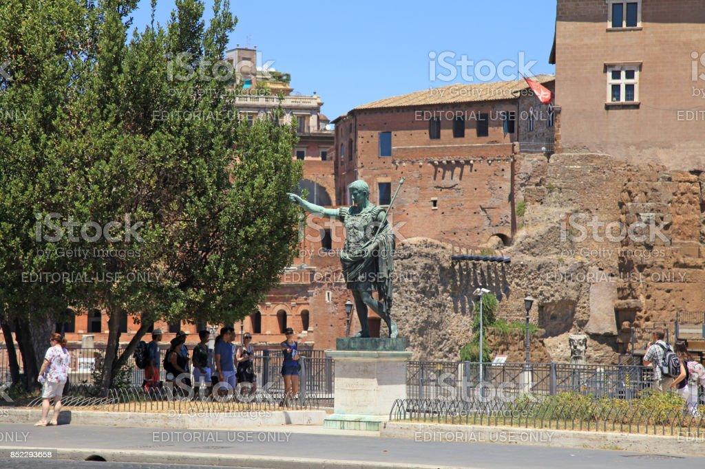 Tourists and bronze statue of emperor Caesar Augustus, Rome, Italy. stock photo