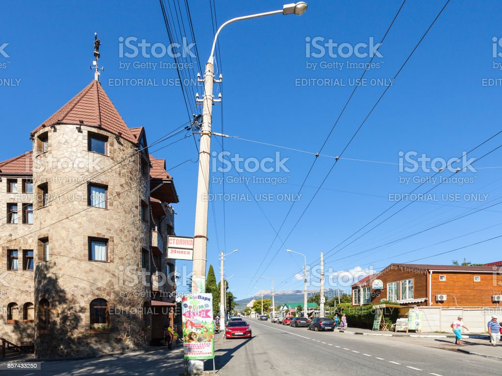 tourists and cars on Gorkiy Street in Alushta city stock photo