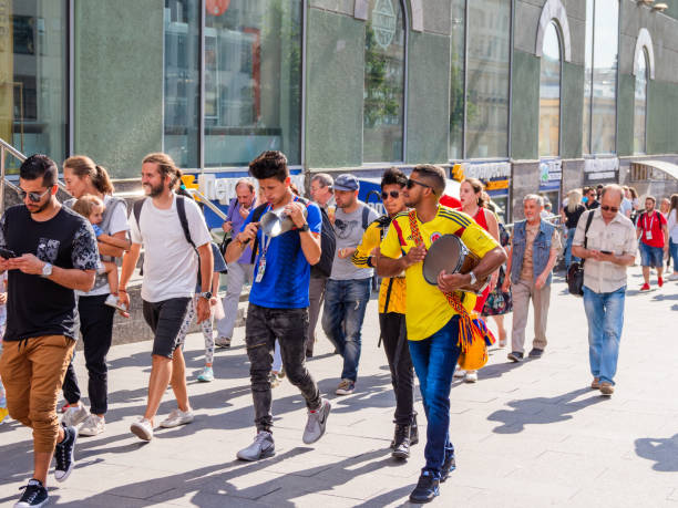 Tourists and local football fans walking on Nikolskaya street before game Russia-Spain (FIFA World Cup 2018). stock photo