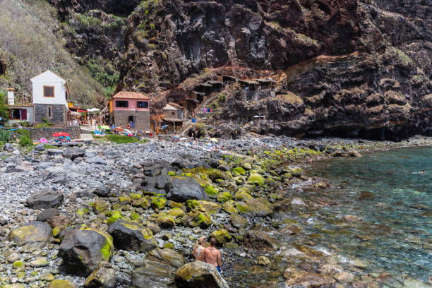Tourists and local people bathing on