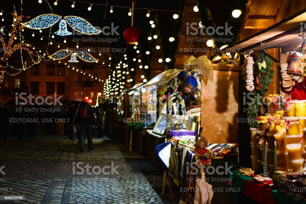 Tourists and local people walking at Christmas fair at Rynok Square in Lviv, Ukraine stock photo