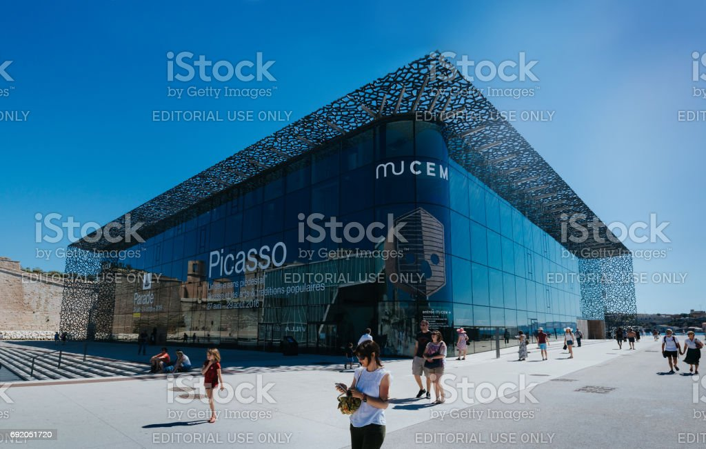 MARSEILLES, FRANCE - JUNE 22, 2016: Tourists and local people walking in front of the modern building of Museum of European and Mediterranean Civilizations (MuCEM). stock photo