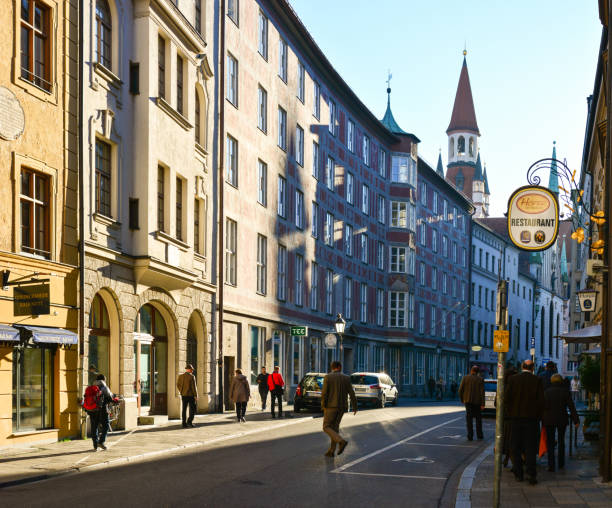 Tourists and locals walking by old town in Munich city stock photo