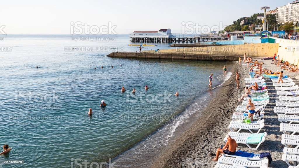 tourists and loungers on beach in Alushta city stock photo