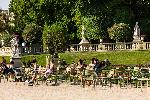 Tourists and Parisians relaxing in the Luxembourg Gardens. Paris, France