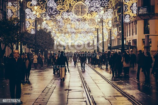 istock Tourists and people walking at christmas night 637275374