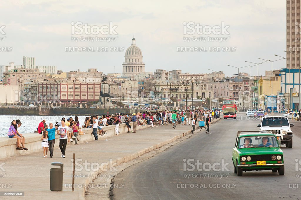 Tourists and Residents Enjoying the Malecón of Havana Cuba stock photo