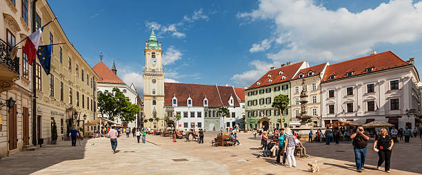 Tourists and residents on Main City Square in Bratislava, Slovakia stock photo