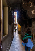Venice, Italy, September 28, 2015 : Tourists and residents walk around quiet streets in old town of Venice, Italy.