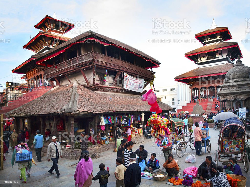 Tourists and residents walk on the Durbar square in Kathmandu. royalty-free stock photo
