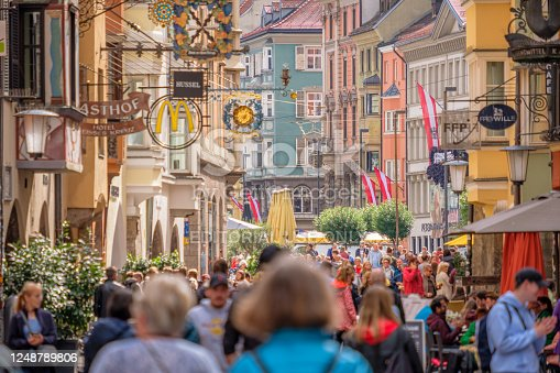Innsbruck, Austria - September 25, 2019: On a rainy September day, tourists and residents are walking the many streets of Innsbruck, a medieval city in the southwest of Austria.