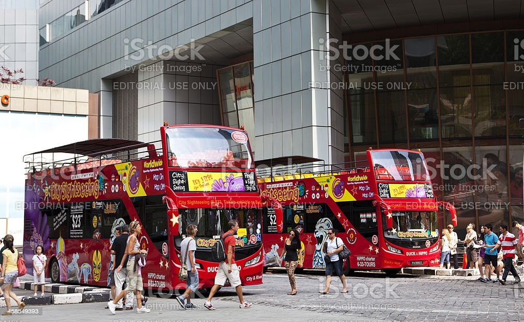 Tourists and sightseeing buses in Singapore. stock photo