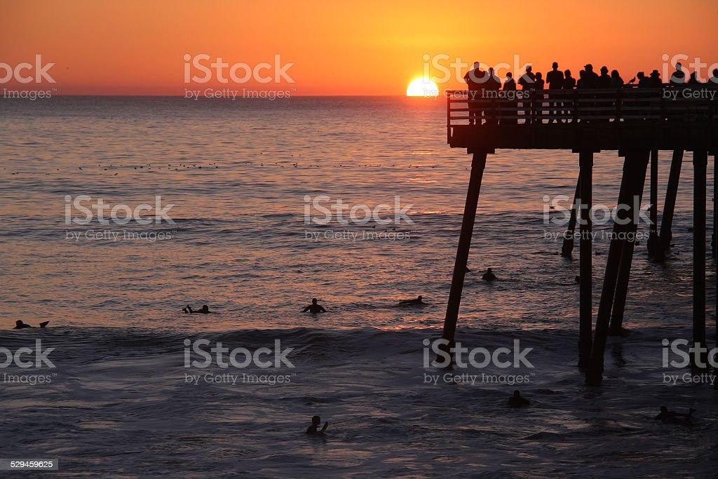 Tourists and Surfers at the Pismo Beach Pier at Sunset stock photo
