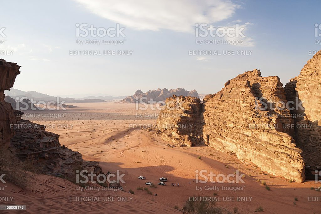 Tourists and the Wadi Rum desert in Jordan royalty-free stock photo