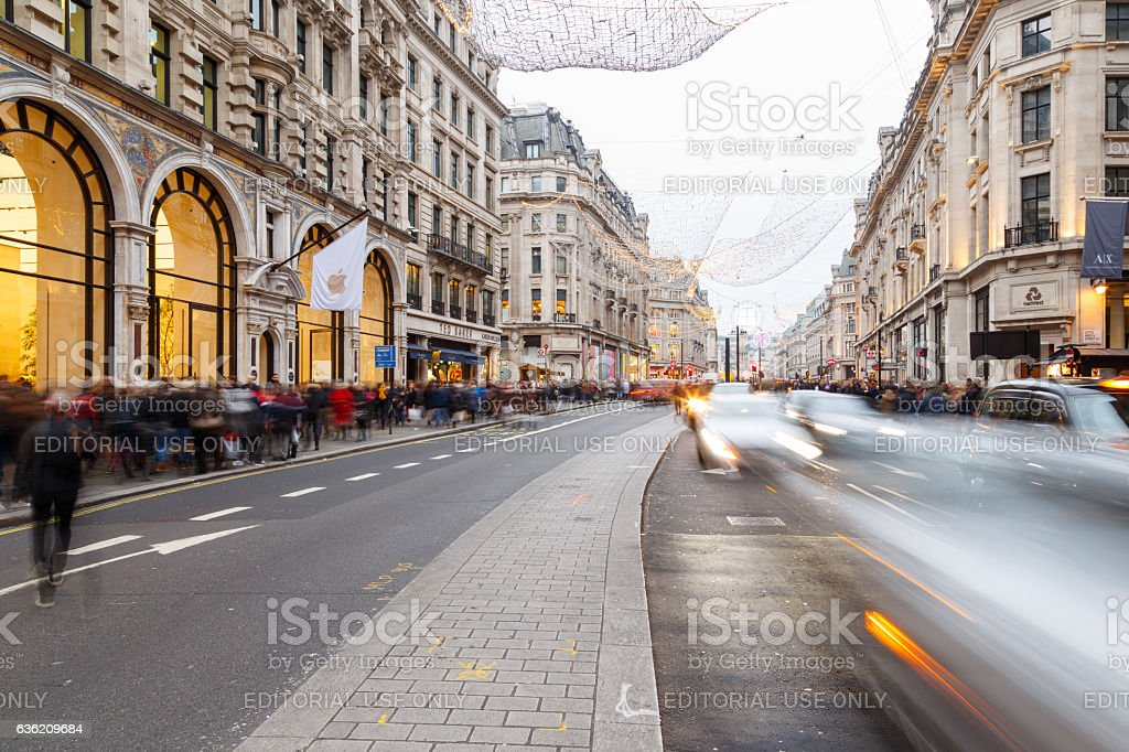 Tourists and traffic on Regent Street, London, England. stock photo