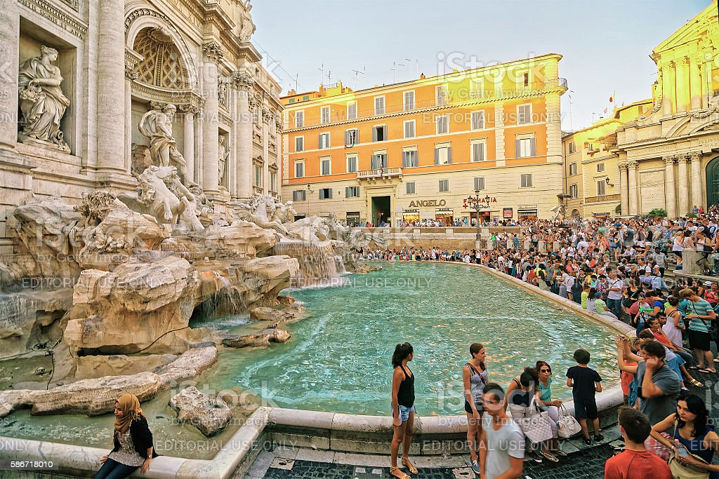 Tourists and Trevi Fountain in Rome in Italy stock photo
