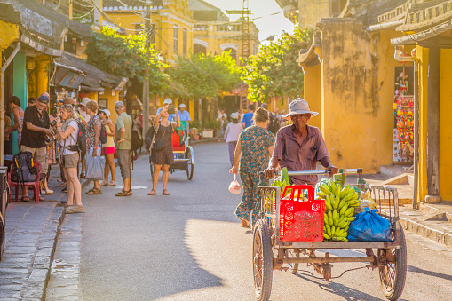 Tourists and Vietnamese people in Hoi An streets