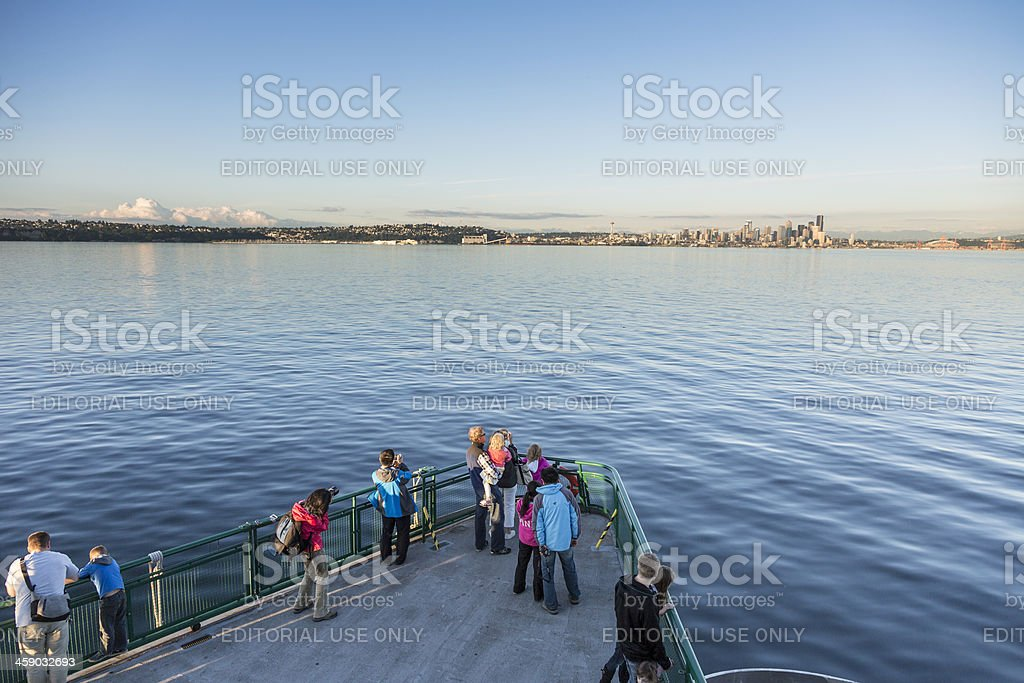 Tourists approaching Seattle on an evening ferry royalty-free stock photo