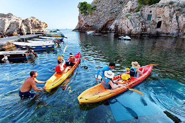 Tourists are engaged in kayaking - Dubrovnik, Dalmatia, Croatia - foto de stock