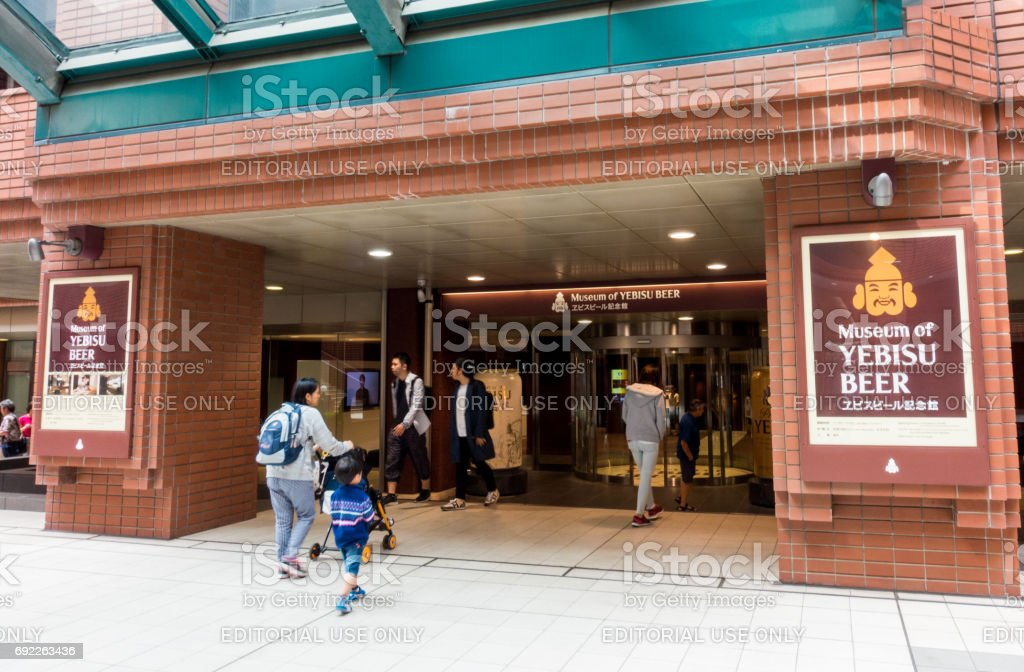 Tourists are entering Yebisu Beer museum. stock photo