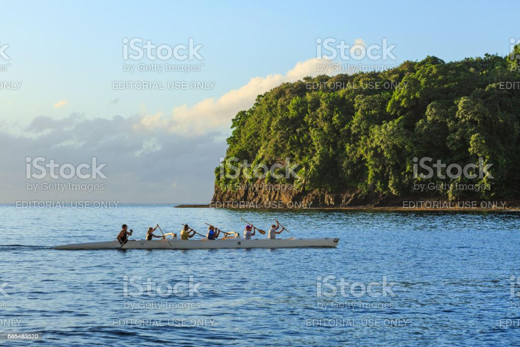 Tourists are kayaking in Tahiti sea at sunset time in Tahiti Papeete, French Polynesia. stock photo