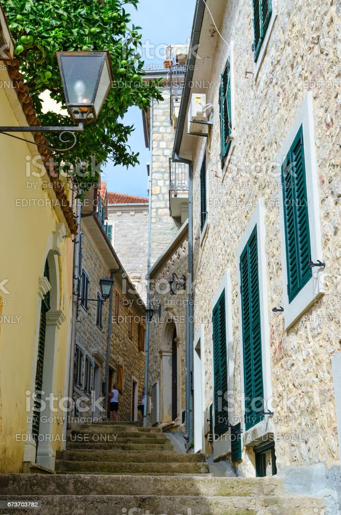 Tourists are photographed on narrow street in Herceg Novi, Montenegro stock photo