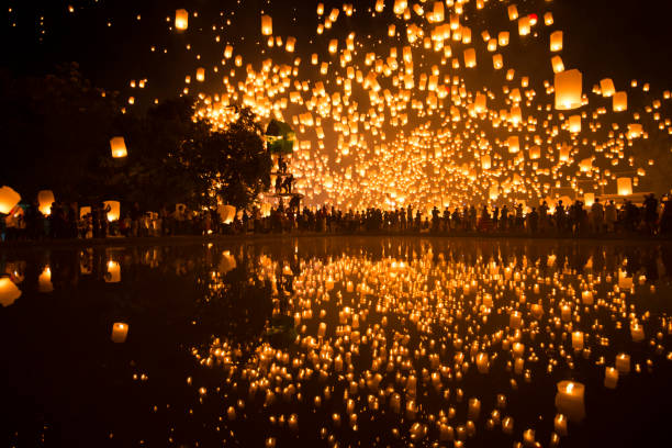 tourists are releasing lanterns inside the temple when yipeng lantern festival before loi kratong festival in chaingmai, thailand - kratong stock photos and pictures