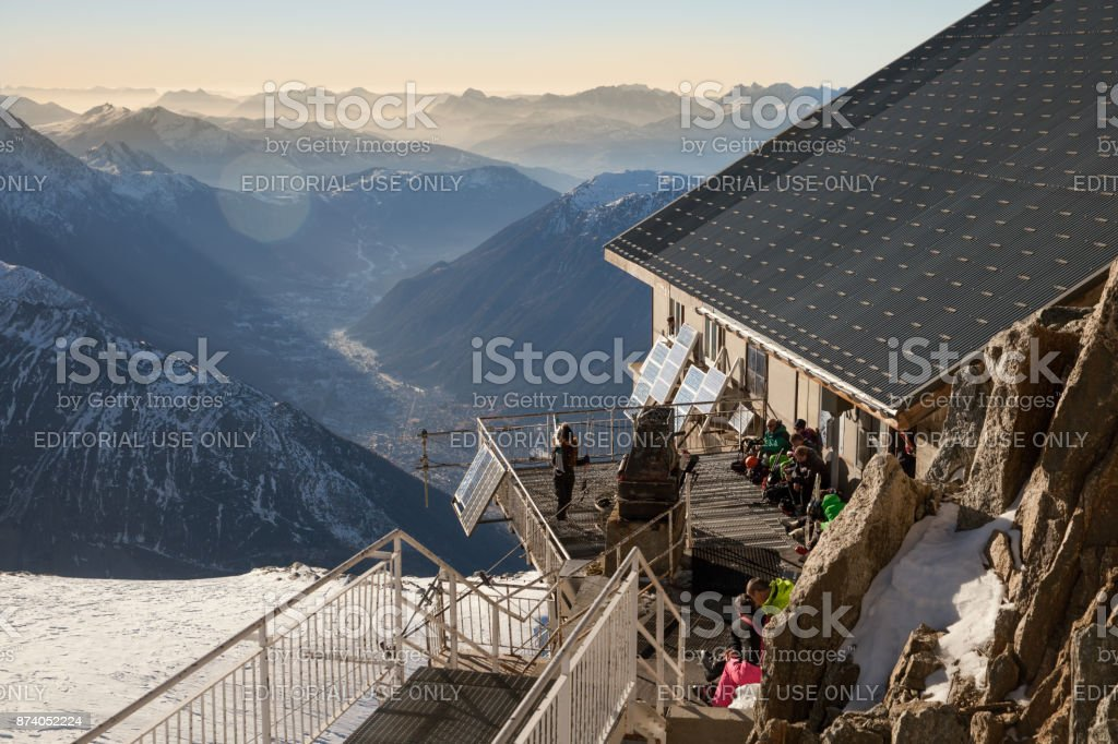 Tourists are resting at hut on the top of Grands Montets in French Alps stock photo